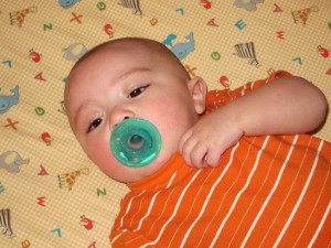 Soothing Cute Baby with Pacifier